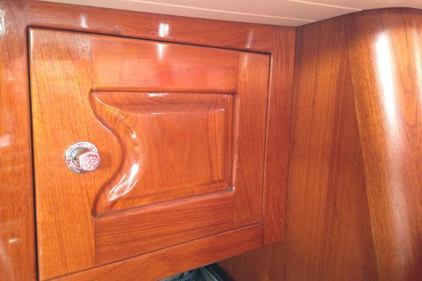 custom teak cabinetry, yacht finish varnnish doors